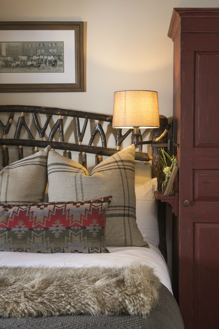 accent-pillows-bed-rustic-ranch-bedroom-interior-design