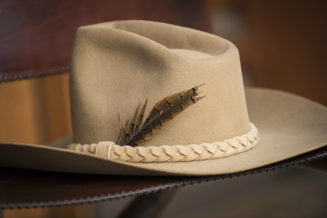 cowboy-hat-with-feather-close-up