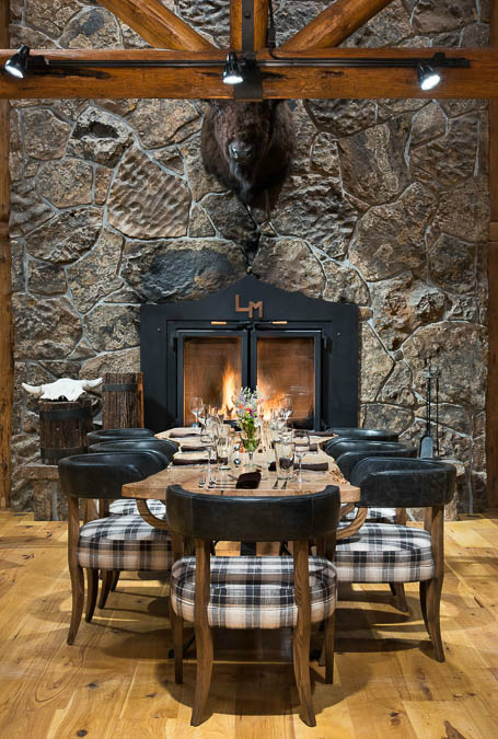 large-dining-table-in-front-of-fireplace-restaurant-lodge-big-sky-mt