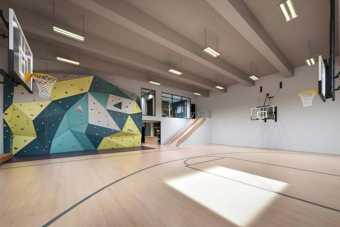 montana-lodge-gym-basketball-court-rock-wall-design